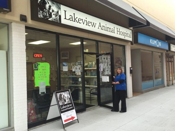 woman holding door open to lakeview animal hospital